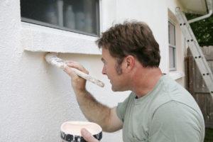 Man Painting the Exterior of a Pasadena Rental Property
