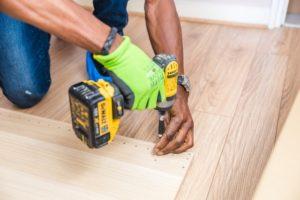 Person Performing Maintenance on Hardwood Floors