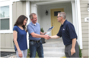 New Tenants Shaking the Landlord's Hand After Signing a Lease