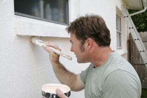 Man Painting the Exterior of a Rochester Rental Property