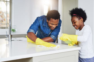 Exeter Family Cleaning the Kitchen
