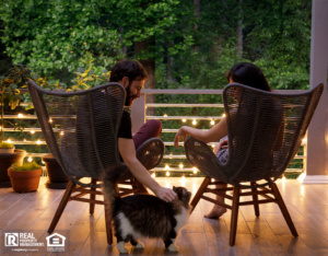 Couple Sitting on Outdoor Patio with String Lights