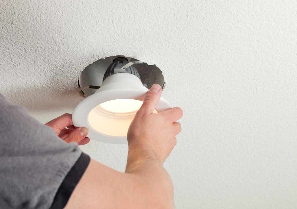 Cambridge Property Manager Installing an Energy Efficient Light Fixture