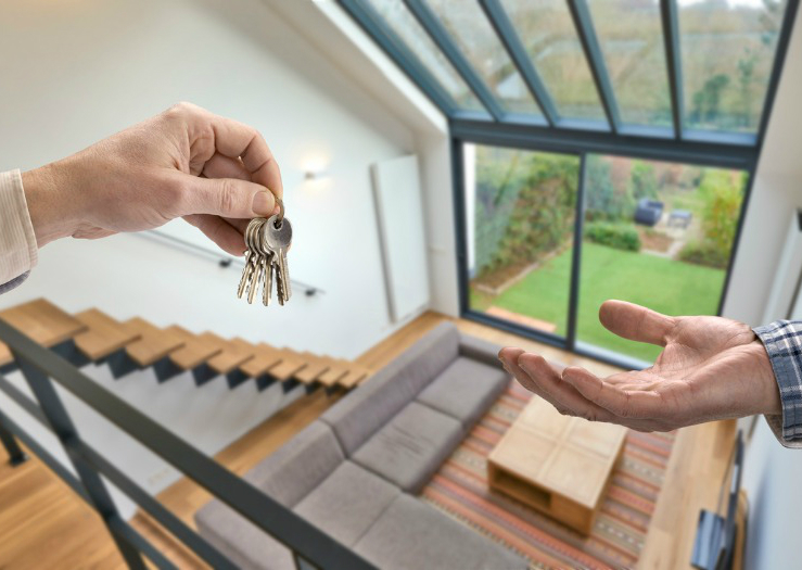 Resident Handing Keys to a Guest After Subletting Your Jamaica Plain Rental Property as an Airbnb