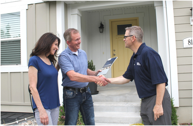 New Tenants in Bothell Shaking the Landlord's Hand After Signing a Lease