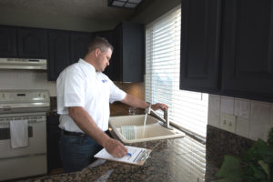 Real Property Management Eclipse staff inspecting the sink