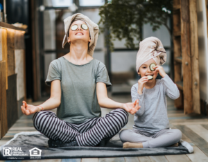 Mother and Daughter Practicing Yoga in Their Shoreline Home