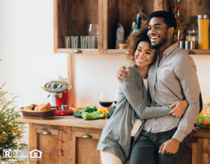 appy millennial couple embracing in the kitchen