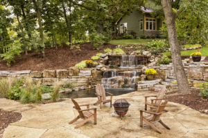 Houston Rental Property with Elaborate Landscaping, Concrete Patio, and Custom Waterfall