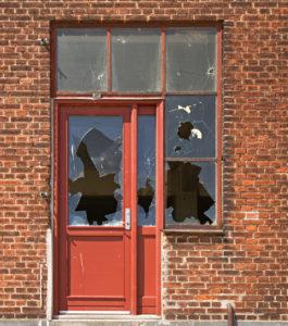 Houston Rental Property with a Broken-In Door and Windows