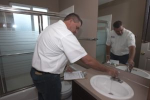 RPM Manager Inspecting the Bathroom Sink