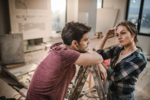 Young Couple Stressed Over House Flipping in Spring