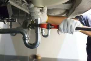 Local Plumber Fixing the Sink at a Freeport Rental Property