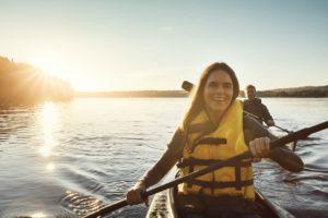 Humble Woman Wearing a Lifejacket while Kayaking