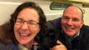 Two Happy Raleigh Residents with their Cute Dog