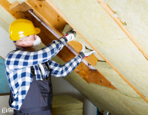 Maintenance Man Working on Insulation in the Attic of a Baxter Rental Home