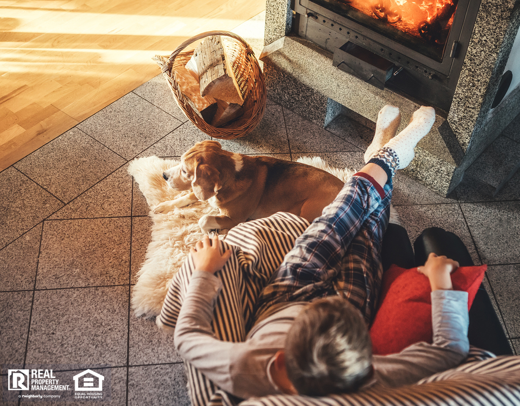 Child and Dog Sitting in Front of Fireplace in Cozy Living Room During Fall
